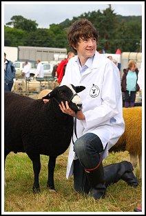 Boy with Black Sheep at Chagford Show. Rob Pendleton Dartmoor